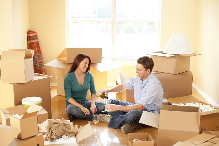 Couple Moving Into Apartment
